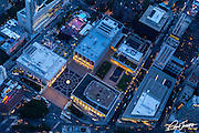 Aerial view of Lincoln Center at dusk during a summer outdoor concert, New York City, photographed from a helicopter.