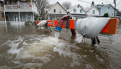 Water pours out of a hose as water is pumped out of a flooded home in Gatineau, Quebec, Canada., Monday May 8, 2017. Photo by Adrian Wyld /The Canadian Press/ABACAPRESS.COM