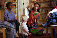 Audrey, telling stories to kids in the Mulitcultural Biblioteque de L'Ardoise, in sion