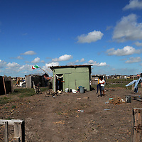 Aug 10, 2010 - Matamoros, Mexico - The Colonia Leyes De La Reforma also known by residents as 'the dump' because it is located on the edges of the city dump of Matamoros Mexico. The Community is made up of Hundreds of small shacks made from anything found in the area.  The Frank Ferree Border Relief brings donated food, clothes and other necessities to the people of this community and others like it along the Rio Grange Valley Border region of Mexico. This  Organization which was started by Frank Ferree a former World War I soldier who moved to the Rio Grande Valley in Texas to farm citrus, but ended up devoting his life to helping the poor across the border from his home in Harlingen Texas. Ferree received a Presidential Medal of Freedom from the Former President Reagan and was nominated for a Nobel Peace Prize. .(Credit Image: © Josh Bachman/ZUMA Press)