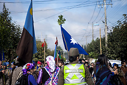 April 14, 2018 - Osorno, Chile - Members of Mapuche - Williche communities marched through the streets of Osorno, Chile, on 13 April 2018 in support of the Machi (Mapuche doctor) Celestino Córdova ancestral authority who is imprisoned for the Luchsinger MacKay case, has been on hunger strike for more than 90 days, demanding to leave for 48 hours spiritual. They also protested against mining companies, hydroelectric companies and forestry companies that invade their territories in Osorno, Chile. (Credit Image: © Fernando Lavoz/NurPhoto via ZUMA Press)