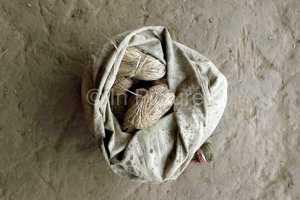 A bag of hemp fibre (cannabis sativa) in the Hmong Lai village of Ban Chalern, Phongsaly province, Lao PDR. Making hemp fabric is a long and laborious process; the end result is a strong durable cloth with qualities similar to linen which the Hmong Lai women make into skirts for their traditional clothing. In Lao PDR, hemp is now only cultivated in remote mountainous areas of the north.