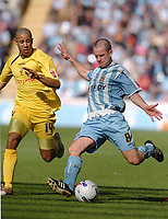 Photo: Leigh Quinnell.<br /> Coventry City v Preston North End. Coca Cola Championship. 01/04/2006. Coventrys Michael Doyle crosses the ball in front of Prestons Tyrone Mears.