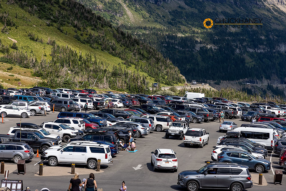 Crowded Logan Pass Parking Lot in Glacier National Park, Montana, USA