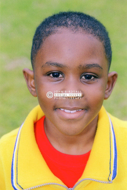 Portrait of young black boy smiling,
