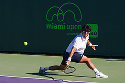 March 23, 2018 - Key Biscayne, FL, U.S. - KEY BISCAYNE, FL - MARCH 23: Hyeon Chung (KOR) in action on Day 5 of the Miami Open at Crandon Park Tennis Center on March 23, 2018, in Key Biscayne, FL. (Photo by Aaron Gilbert/Icon Sportswire) (Credit Image: © Aaron Gilbert/Icon SMI via ZUMA Press)