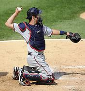 CHICAGO - JULY 09:  Joe Mauer #7 of the Minnesota Twins catches against the Chicago White Sox on July 9, 2011 at U.S. Cellular Field in Chicago, Illinois.  The White Sox defeated the Twins 4-3.  (Photo by Ron Vesely)  Subject: Joe Mauer