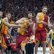 Galatasaray's Luksa ANDRIC (C), Caner TOPALOGLU (2ndR),Tutku ACIK (R) and Fenerbahce's Sean Gregory MAY (L) during their Turkish Basketball league Play Off Final fourth leg match Galatasaray between Fenerbahce Ulker at the Abdi Ipekci Arena in Istanbul Turkey on Saturday 11 June 2011. Photo by TURKPIX