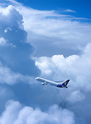 Airliner flying in cumulus clouds