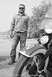Matt McManus poses with his 1936 Harley-Davidson Knucklehead during Stage 13 (257 miles) of the Motorcycle Cannonball Cross-Country Endurance Run, which on this day ran from Elko, NV to Meridian, Idaho, USA. Thursday, September 18, 2014.  Photography ©2014 Michael Lichter.