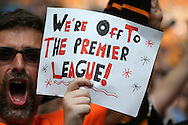 """a Hull City fan holds up his sign saying """"We're Off To The Premier League"""" after full time. Skybet football league Championship play off final match, Hull city v Sheffield Wednesday at Wembley Stadium in London on Saturday 28th May 2016.<br /> pic by John Patrick Fletcher, Andrew Orchard sports photography."""