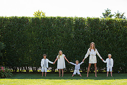 woman with four children all dressed up in The Hamptons