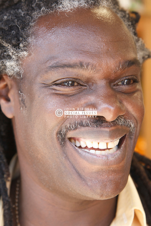 Portrait of black man laughing. Cleared for Mental Health issues.