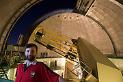 Lick Observatory on Mt. Hamilton. San Jose, California. Chris McCarthy, astronomer, with the 120-inch telescope