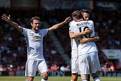 Wayne Rooney of Manchester United celebrates with Ander Herrera and Juan Mata after scoring a goal to make it 0-2 - Rogan Thomson/JMP - 14/08/2016 - FOOTBALL - Vitality Stadium - Bournemouth, England - Bournemouth v Manchester United - Premier League Opening Weekend.