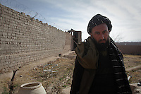 Haji Suleiman, the father in law of Bibi Aisha, in jail in Oruzgan Province, in southern Afghanistan. Suleiman, 45, is the only man to have been arrested for slicing off Aisha's ears and nose in 2009, as a punishment for running away. Originally from Khush Kadir village, he was arrested in Chora District Centre and brought the provincial capital, Tirin Kot. There are 96 inmates in the prison built for 35, according to the guards. Suleiman, who has not got a defence lawyer, said he is teaching himself to read and write in prison. He has not got a defence lawyer and he insists he is innocent.