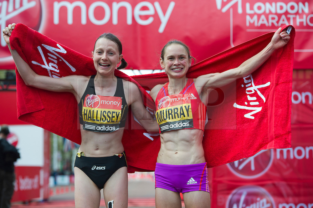© London News Pictures. 22/04/2012. London, UK. Claire Hallissey and Freya Murray of Great Britain celebrate finishing the Virgin London Marathon 2012 on April 22, 2012 in London, England . Photo credit : Ben Cawthra /LNP