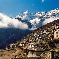 Kwangde Peak towers over traditional houses Namche Bazar in 1986. Most house have now been modernized or replaced.