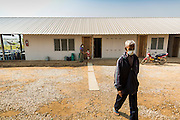 03 MARCH 2104 - MAE KASA, TAK, THAILAND: A patient walks across the compound at the Sanatorium Center for Border Communities in Mae Kasa, about 30 minutes north of Mae Sot, Thailand. The Sanatorium provides treatment and housing for people with tuberculosis in an isolated setting for about 68 patients, all Burmese. The clinic is operated by the Shoklo Malaria Research Unit and works with several other NGOs that assist Burmese people in Thailand. Reforms in Myanmar have alllowed NGOs to operate in Myanmar, as a result many NGOs are shifting resources to operations in Myanmar, leaving Burmese migrants and refugees in Thailand vulnerable. Funding cuts could jeopardize programs at the clinic. TB is a serious health challenge in Burma, which has one of the highest rates of TB in the world. The TB rate in Thailand is ¼ to ⅕ the rate in Burma.        PHOTO BY JACK KURTZ