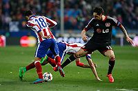 Atletico de Madrid´s Jesus Gamez (L) and Bayer 04 Leverkusen´s Hilbert during the UEFA Champions League round of 16 second leg match between Atletico de Madrid and Bayer 04 Leverkusen at Vicente Calderon stadium in Madrid, Spain. March 17, 2015. (ALTERPHOTOS/Victor Blanco)