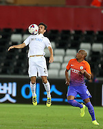 Jack Cork of Swansea city (l) in action.EFL Cup. 3rd round match, Swansea city v Manchester city at the Liberty Stadium in Swansea, South Wales on Wednesday 21st September 2016.<br /> pic by  Andrew Orchard, Andrew Orchard sports photography.