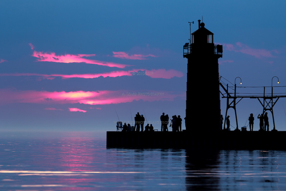 The warmth of April frees Lake Michigan of ice and the the fishermen take to the pier and observe a fiery sunset