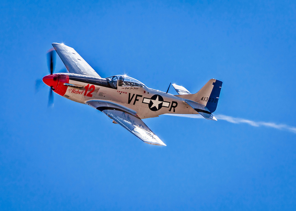 """P-51D Mustang, """"The Rebel 12"""", flown by Doug Matthews of Wellington, Florida in the Unlimited Category, Silver Race, Sunday at Reno."""