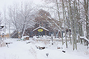Shops in a snow storm in Taos, New Mexico