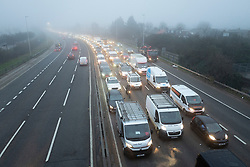 © Licensed to London News Pictures. 03/03/2021. London, UK. Cars drive through heavy fog on the A102 Blackwall Tunnel approach. A yellow weather warning for fog is in place for parts of South East England . Photo credit: George Cracknell Wright/LNP