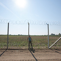 Civilian workers install additional razor wire to the fence being built on the border between Hungary and Serbia near Asotthalom (about 190 km South of capital city Budapest), Hungary on August 30, 2015. ATTILA VOLGYI