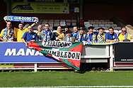 Traveling AFC Wimbledon fans during the EFL Sky Bet League 1 match between AFC Wimbledon and Rochdale at the Cherry Red Records Stadium, Kingston, England on 30 September 2017. Photo by Matthew Redman.