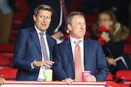 Joshua Harris, the Crystal Palace American co-owner ® with Steve Parish, the Crystal Palace chairman/co-owner talking in the stands before k/o. Premier League match, Crystal Palace v Stoke city at Selhurst Park in London on Sunday 18th Sept 2016. pic by John Patrick Fletcher, Andrew Orchard sports photography.