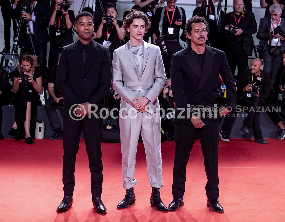 """VENICE, ITALY - SEPTEMBER 02: Haider Ackermann, Timothee Chalamet and Kid Cudi attend """"The King"""" red carpet during the 76th Venice Film Festival at Sala Grande on September 02, 2019 in Venice, Italy."""