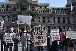 April 14, 2018 - Philadelphia, Pennsylvania, United States - About twenty gather to protest the last retaliation attacks by US, UK and France on Syria, at Dilworth Plaza near City Hall in Philadelphia, PA on April 14, 2018. (Credit Image: © Bastiaan Slabbers/NurPhoto via ZUMA Press)