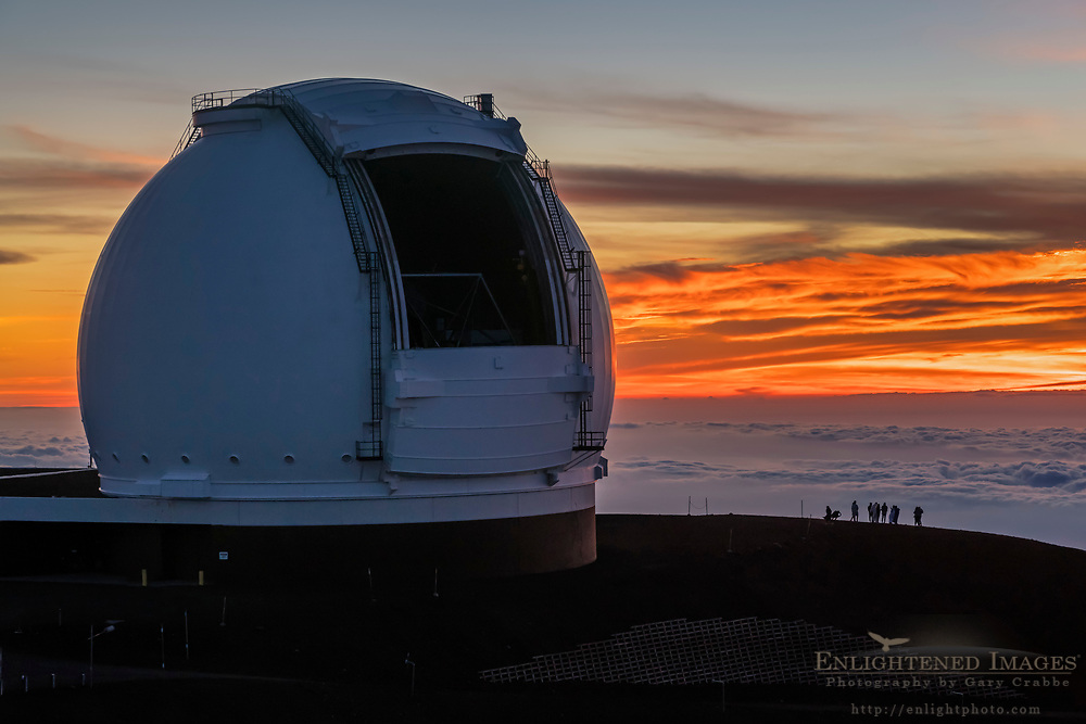 Visitors watch the sunset next to the Keck Telescope atop Mauna Kea, Big Island of Hawai'i, Hawaii