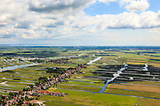 Nederland, Noord-Holland, Gemeente Wormerland, 14-06-2012; Polder Wormer, Jisp en Nek met de dorpen Wormer en Jisp (tweede plan). De verkaveling in het gebied is het resultaat van veenontginning. Aan de horizon Purmerend  met IJsselmeer, midden rechts de droogmakerij De Wijde Wormer (Wijdewormer)..Polder in province North Holland (above Amsterdam) with villages. The division in plots in the area is the result of peat extraction..luchtfoto (toeslag), aerial photo (additional fee required);.copyright foto/photo Siebe Swart