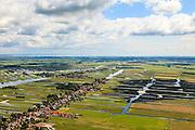 Nederland, Noord-Holland, Gemeente Wormerland, 14-06-2012; Polder Wormer, Jisp en Nek met de dorpen Wormer en Jisp (tweede plan). De verkaveling in het gebied is het resultaat van veenontginning. Aan de horizon Purmerend  met IJsselmeer, midden rechts de droogmakerij De Wijde Wormer (Wijdewormer)..Polder in province North Holland (above Amsterdam) with villages. The division in plots in the area is the result of peat extraction..luchtfoto (toeslag), aerial photo (additional fee required);.copyright foto/photo Siebe Swart