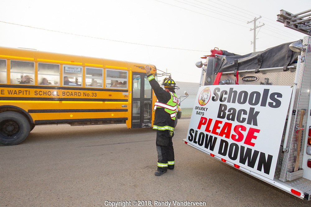 Photo Randy Vanderveen<br /> Bezanson,County of Grande Prairie, Alberta<br /> 2018-09-04<br /> County of Grande Prairie Firefighter Jordan Storey, of Station 9 Bezanson, reminds motorists heading to or past the Bezanson school to slow down and use caution as students return to school for another year Tuesday, Sept. 4 morning.