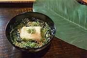 Wakame soup with house-made sesame tofu at Kajitsu, 125 E. 39th St., New York. The leaf which covers the dish at service is a magnolia leaf.