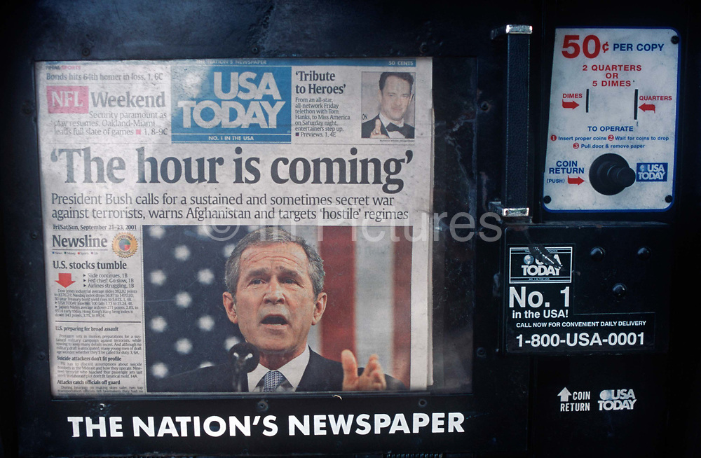 A week after the 9-11 terrorist attacks on the Twin Towers and the Pentagon, the headline on the front page of the USA Today newspaper runs a quote from President George W Bush - The Hour is Coming - a message of imminent reprisals against al Qaeda terrorists and the followers in Afghanistan of the Saudi-born Osama bin Laden, on 21st September 2001, New York, USA.