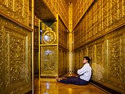 18 NOVEMBER 2017 - YANGON, MYANMAR: A man meditates in a chamber in the base of Botataung Pagoda in Yangon. Pope Francis is visiting Myanmar, September 27-30. It will be the first visit by a Pope to the overwhelmingly Buddhist nation. He will meet with the Aung San Suu Kyi and other political leaders and will participate in two masses in Yangon. The Pope is expected to talk about Rohingya issue while he is in Myanmar. The Rohingya are persecuted Muslim minority in Rakhine state in western Myanmar. It's not clear how Myanmar's politically powerful nationalist monks will react if the Pope openly talks about the Rohingya. In the past, the monks have led marches and demonstrations against foreign diplomatic missions when foreign ambassadors have spoken in defense of the Rohingya. There is not much visible sign of the Pope's imminent visit in Yangon, which is estimated to be more than 90% Buddhist.    PHOTO BY JACK KURTZ