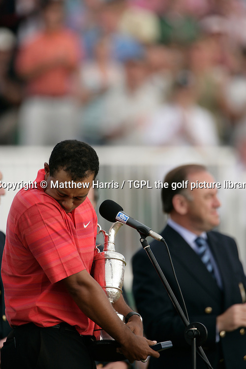 Tiger WOODS (USA) hold's the famous claret jug trophy for the 3rd time and holds back the emotion of the recent passing away of his father and mentor Earl during fourth round The Open Championship 2006,Royal Liverpool, Hoylake,Wirral,England.Peter Dawson of the R&A is in the background.