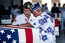 JOINT BASE PEARL HARBOR-HICKAM, Hawaii (Aug. 1, 2018) Korean War veterans pay respects after an honorable carry ceremony at Joint Base Pearl Harbor-Hickam, Hawaii, Aug. 1, 2018. The United Nations Command recently repatriated 55 transfer cases from North Korea to the U.S. that contain what are believed to be the remains of American service members lost in the Korean War. (U.S. Air Force photo by Senior Airman Apryl Hall/Released)180801-F-AN072-0064