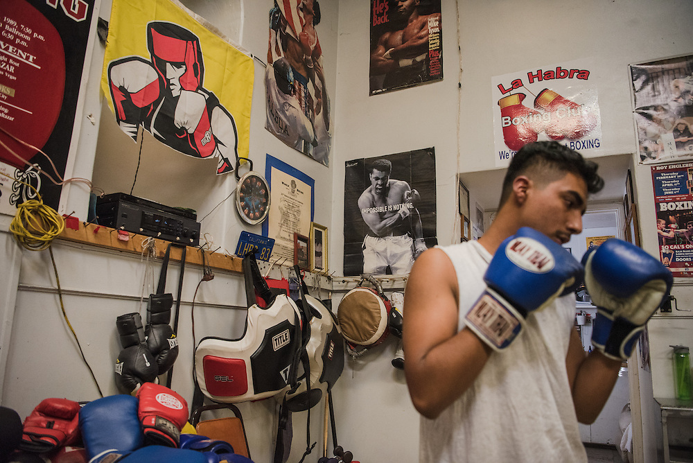 A high school student and member of the La Habra Boxing Club gets ready to spar on Wednesday, November 3, 2016 at the boxing gym in La Habra, California. <br /> <br /> Photo by Morgan Lieberman/ Sports Shooter Academy