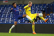 AFC Wimbledon midfielder Mitchell (Mitch) Pinnock (11) battles for possession with Juan Castillo of Chelsea (54) during the EFL Trophy match between U21 Chelsea and AFC Wimbledon at Stamford Bridge, London, England on 4 December 2018.