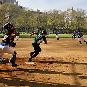 A women's softball game during a warm spring day in Central Park, Manhattan, New York, USA. Photo Tim Clayton