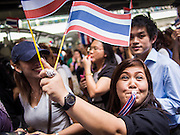 29 NOVEMBER 2013 - BANGKOK, THAILAND: Anti-government protestors march down Sukhumvit Road in Bangkok towards the US Embassy. Several thousand Thai anti-government protestors marched on the US Embassy in Bangkok. They blew whistles and asked the US to honor their efforts to unseat the elected government of Yingluck Shinawatra. The anti-government protestors marched through several parts of Bangkok Friday paralyzing traffic but no clashes were reported, even after a group protestors tried to occupy Army headquarters.         PHOTO BY JACK KURTZ