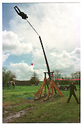 Richard Wicks being fired for the first time by Trebuchet..Dave Aitkenhead  underneath on right. April 2000Dangerous Sports Club first trebuchet human catapult. 2000<br />© Copyright Photograph by Dafydd Jones<br />66 Stockwell Park Rd. London SW9 0DA<br />Tel 0171 733 0108