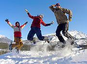 Alaska , Brooks Range. Iniakuk Lake Lodge. Happy snowshoers jumping in the snow of the Brooks Range at Iniakuk Lake Lodge.