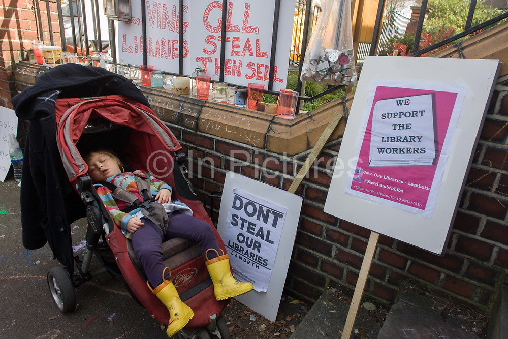 A young protester sleeps outside the now closed Carnegie Library, in Herne Hill, south London on 2nd April 2016. The angry local community in the south London borough have occupied their important resource for learning and social hub for the weekend. After a long campaign by locals, Lambeth have gone ahead and closed the library's doors for the last time because they say, cuts to their budget mean millions must be saved. A gym will replace the working library and while some of the 20,000 books on shelves will remain, no librarians will be present to administer it. London borough's budget cuts mean four of its 10 libraries will either close, move or be run by volunteers.